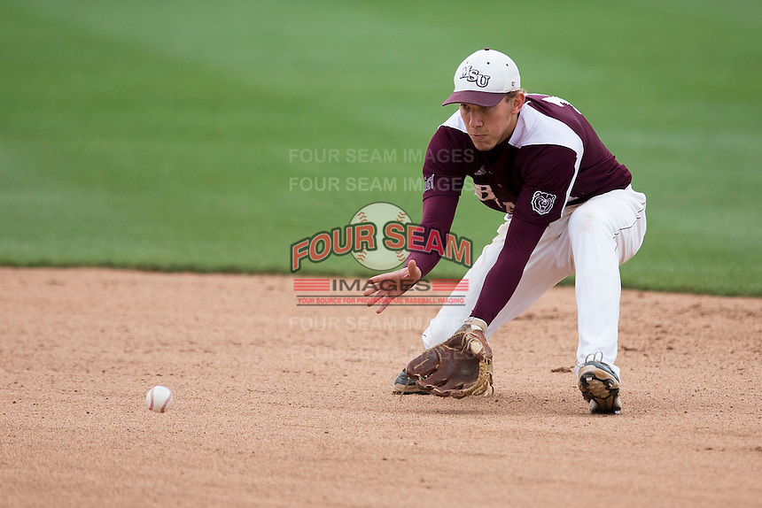 Eric Cheray #14 of the Missouri State Bears fields a ground ball during a game against the Wichita State Shockers at Hammons Field on May 5, 2013 in Springfield, Missouri. (David Welker/Four Seam Images)