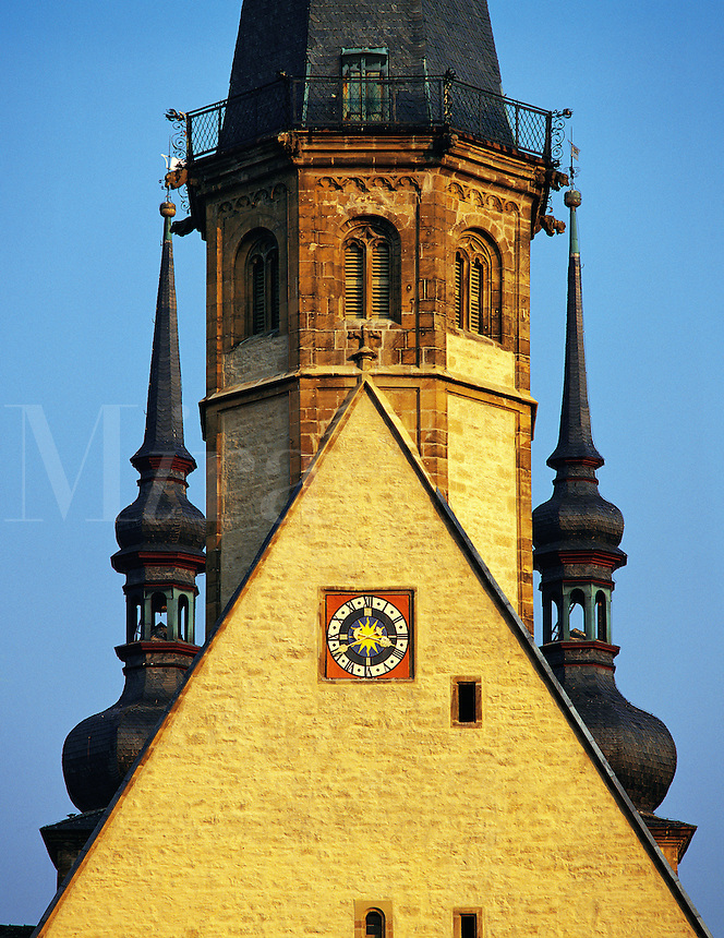 Ornate church steeple with decorated clock and other embellishments in Bad Wimpfen, Bavaria, southern German