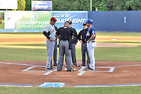 South Atlantic League umpires get the lineup cards from Hickory Crawdads manager Corey Ragsdale (24) and Asheville Tourists manager Warren Schaeffer (13) before game 3 of the South Atlantic League Championship Series between the Asheville Tourists and the Hickory Crawdads on September 17, 2015 in Asheville, North Carolina. The Crawdads defeated the Tourists 5-1 to win the championship. (Tony Farlow/Four Seam Images)