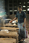 A woman prepares a meal  for a hospitalized family member in the the kitchen at Kibuye Hospital, Karongi District, Western Rwanda