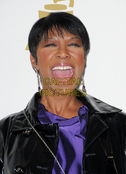 NATALIE COLE <br /> attends The GRAMMY Nominations Concert Live!! held at Nokia Theatre L.A. Live in Los Angeles, California on December 3rd 2008.<br /> portrait headshot dangly earrings purple mouth open funny <br /> CAP/DVS<br /> &copy;Debbie VanStory/Capital Pictures