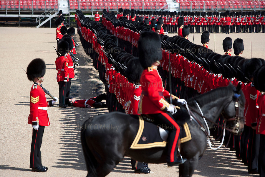 "Mcc0023074 . Daily Telegraph..A Grenadier Guardsman ""piles in"" whist rehearsing on Horseguards for Trooping the Colour in celebration of the Queen's Birthday on June 12 ..The Grenadier Guards only recently finished a six month tour of Helmand , Afghanistan on March 31...London 19 June 2010......Not AP.Not Reuters.Not PA.Not Getty.Not AFP."