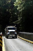 Logging truck crossing wooden bridge close to Port Renfrew, Vancouver Island, British Columbia, Canada.