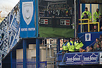 "Police surveilence officers on duty inside Fratton Park stadium as Portsmouth take on take on local rivals Southampton in a Championship fixture. Around 3000 away fans were taken directly to the game in a fleet of buses in a police operation known as the ""coach bubble"" to avoid the possibility of disorder between rival fans. The match ended in a one-all draw watched by a near capacity crowd of 19,879."