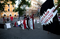 """Rome, 26/06/2020. Today, NonUnaDiMeno (Not One Woman Less, 1.) held a demo in Piazza dell'Esquilino in support and solidarity with all the women, especially after the Covid19/Coronavirus pandemic emergency which has been particularly heavy for women, to the women who are fighting patriarchal, racist, institutional, housing, environmental and economic violence. The demo was called to firmly demand the end to male and gender-based violence against women and the Feminicides, to fight for the same working rights for all women, supporting abortion's rights and self-determination, and to end all forms of discrimination against women and the LGBTQIPA+ people. From the organiser Facebook event page (2.): «If the dirty clothes are washed in the house, we take them to the square. We know well, precisely because it is secret, that the house is not a safe place, and more than ever in the hard months of the lockdown, the house has been a place of violence and exploitation. We never stopped, we worked more than normal, overlapping housework, childcare and teleworking, inventing a way to fill the void left by school and not filled with """"DAD"""" [Didattica a distanza, distance teaching and learning, ndr], we continued to work in hospitals and social services - in the sanitation, cleaning and sanitation services, without protection tools, we have kept production going for little money and many risks in factories, logistics and large-scale distribution. For us, the lockdown has a meaning that is the victim of domestic violence and, today, the resumption of the war on women […]».<br /> <br /> Footnotes & Links:<br /> 1. https://nonunadimeno.wordpress.com/ & https://www.facebook.com/nonunadimenoroma/<br /> 2. http://bit.do/fGekP"""