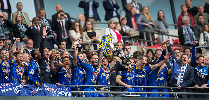 AFC Wimbledon's captain Barry Fuller lifts the League 2 play-off final trophy after his side's 2-0 victory<br /> <br /> Photographer Craig Mercer/CameraSport<br /> <br /> Football - The Football League Sky Bet League Two Play-Off Final - AFC Wimbledon v Plymouth Argyle - Monday 30 May 2016 - Wembley Stadium - London<br /> <br /> World Copyright &copy; 2016 CameraSport. All rights reserved. 43 Linden Ave. Countesthorpe. Leicester. England. LE8 5PG - Tel: +44 (0) 116 277 4147 - admin@camerasport.com - www.camerasport.com