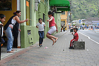 Skipping rope on the street. Banos, Ecuador