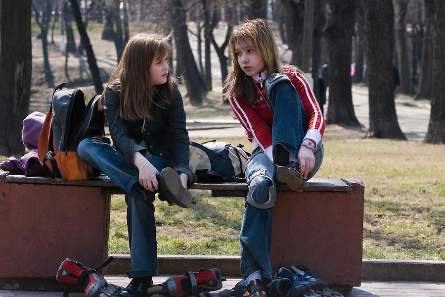 Moscow, Russia, 29/04/2006..Twelve year old Irina Timoshenko with her friend Yulia Martinova in Lefortovo Park near their home.