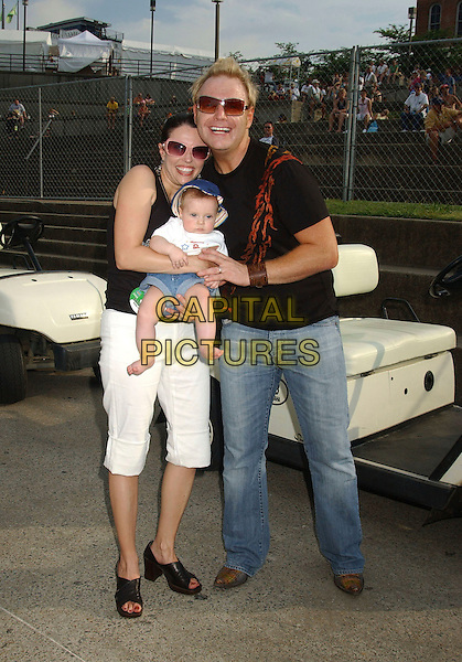 BOBBY PINSON , WIFE LUCY & BABY CASH.2006 CMA Music Festival held at the Greased Lightening Daytime Stage at Riverfront Park, Nashville, Tennessee, USA,10 June 2006..full length music country family.Ref: ADM/LF.www.capitalpictures.com.sales@capitalpictures.com.©Laura Farr/AdMedia/Capital Pictures.