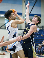 Nick Buchanan of Springdale Har-Ber shoots as Dillon Bailey of Bentonville West defends Friday, Feb. 14, 2020, at Wildcat Arena in Springdale. Go to nwaonline.com/prepbball/ to see more photos.<br /> (NWA Democrat-Gazette/Ben Goff)