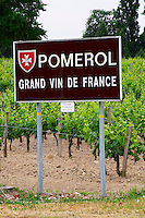 A sign showing the border of the wine district Saying 'Pomerol Grand Vin de France' (Great wine of France). Pomerol Bordeaux Gironde Aquitaine France