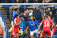 Jack Bonham of Gillinghamcatches the ball under pressure got Christian Burgess of Portsmouth during Portsmouth vs Gillingham, Sky Bet EFL League 1 Football at Fratton Park on 12th October 2019