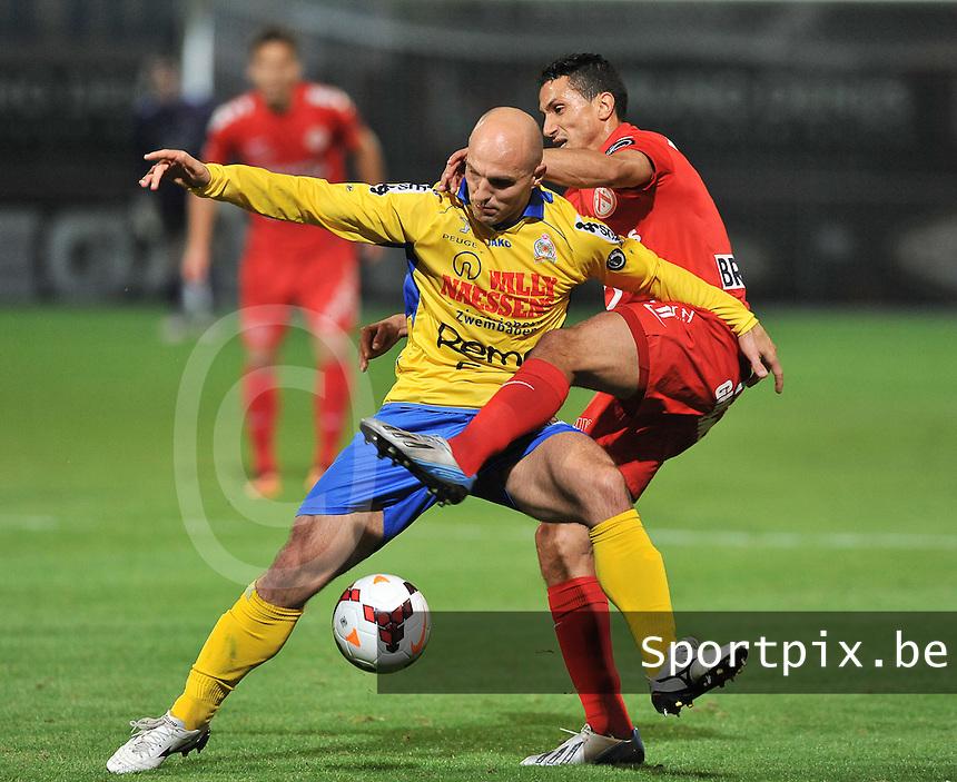 KV Kortrijk - Waasland Beveren : duel tussen Milos Maric en de opzittende Mustapha Oussalah (rechts)<br /> foto VDB / Bart Vandenbroucke