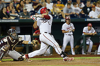 Indiana Hoosiers catcher Kyle Schwarber (10) follows through on his swing in the ninth inning against the Mississippi State Bulldogs during Game 6 of the 2013 Men's College World Series on June 17, 2013 at TD Ameritrade Park in Omaha, Nebraska. Schwarber flied out to deep center field.The Bulldogs defeated Hoosiers 5-4. (Andrew Woolley/Four Seam Images)