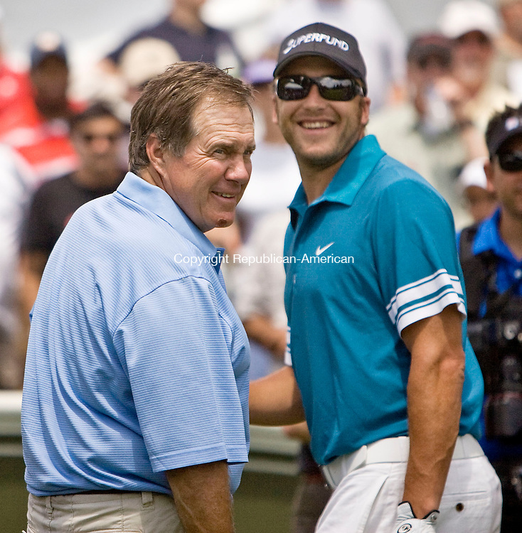 CROMWELL, CT - 23 JUNE 2010 -062310JT07-<br /> New England Patriots Coach Bill Belichick and Olympic gold medalist in alpine skiing Bode Miller meet at the 1st tee during Wednesday's Travelers Celebrity Pro-Am golf event at TPC River Highlands in Cromwell.<br /> Josalee Thrift Republican-American