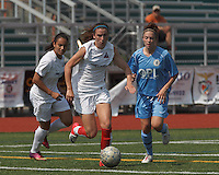 Boston Aztec midfielder/defender Morgan Andrews (10) on the attack.  In a Women's Premier Soccer League (WPSL) match, Boston Aztec (white) defeated Seacoast United Mariners (blue), 2-1, at North Reading High School Stadium on Arthur J. Kenney Athletic Field on on June 23, 2013. Due to injuries through the season, Seacoast United Mariners could only field 10 players.