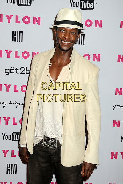EDI GATHEGI.Nylon Magazine's Young Hollywood Party held at the Roosevelt Hotel's Tropicana Bar, Hollywood, California, USA..May 12th, 2010.half length top jacket white cream straw hat trilby fedora goatee facial hair .CAP/ADM/BP.©Byron Purvis/AdMedia/Capital Pictures.