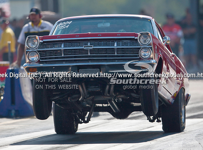 A wheel standing Ford making a run at the O'Reilly Fall Nationals held at the Texas Motorplex in  Ennis, Texas.