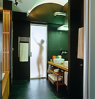Silhouette of a man in the shower in this contemporary bathroom