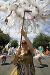 Andrea Thompson twills an umbrella made from plastic bags during the 21st  Annual Fremont Summer Solstice Parade in Seattle on June 21, 2009.  The parade was held Saturday, bringing out painted and naked bicyclists, bands, belly dancers and floats. (Jim Bryant Photo © 2009)