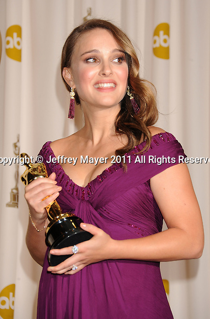 HOLLYWOOD, CA - FEBRUARY 27: Natalie Portman poses in the press room during the 83rd Annual Academy Awards held at the Kodak Theatre on February 27, 2011 in Hollywood, California.
