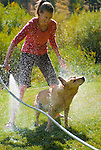 A young woman washes her dog in Jackson, Wyoming.