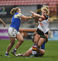Picture by Anna Gowthorpe/SWpix.com - 15/04/2018 - Rugby League - Womens Super League - Bradford Bulls v Leeds Rhinos - Coral Windows Stadium, Bradford, England - Bradford Bulls' Amy Hardcastle is tackled by Leeds Rhinos' Caitlin Beevers and Lois Forsell (left)