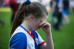 A young home fan in distress during a pitch invasion during the final stages of the match as Blackburn Rovers take on Oxford United in a Sky Bet EFL League One fixture at Ewood Park, Blackburn. The home side had already achieved promotion back to the Championship after one season down in League One. The match ended in a 2-1 victory for the home side, watched by 27,600 spectators which confirmed Blackburn as runners-up in League One.