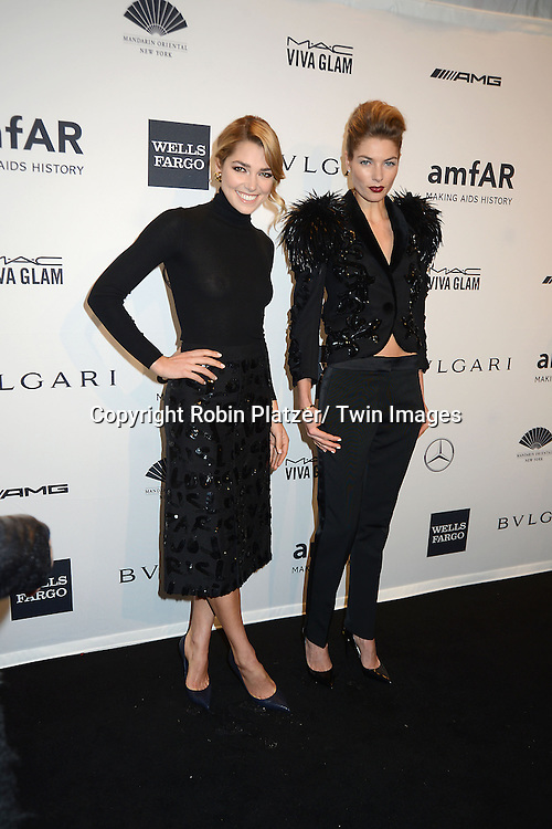 Jessica Hart and sister attends the amfAR New York Gala on February 5, 2014 at Cipriani Wall Street in New York City.