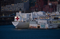 WEEHAWKEN, NJ - APRIL 21: The USNS Comfort navy hospital ship is docked at Pier 90 in Manhattan on April 21, 2020 as seen from Weehawken, New Jersey. NY Gov. Andrew Cuomo said that New York City no longer needs the Navy ship USNS Comfort to combat the coronavirus pandemic. (Photo by Kena Betancur/ VIEWpress via Getty Images)