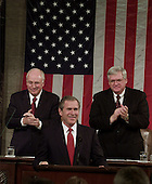 """United States President George W. Bush delivers his address to a Joint Session of the 107th Congress Tuesday February 27, 2001 at the Capitol in Washington. Bush outlined his tax cut proposal and other budget issues for the year. President Bush sought to rally the nation Tuesday behind massive tax cuts, promising to lead Washington along """"a different path"""" with increased spending on popular programs, less government debt and a $1 trillion reserve fund. U.S. Vice President Dick Cheney, left, and U.S. House Speaker Dennis Hastert (Republican of Illinois), right, look on.<br /> Credit: Doug Mills / Pool via CNP"""