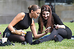 © Joel Goodman - 07973 332324 . 09/06/2016 . Manchester , UK . REBECCA MANN (25) and AMY FORSYTH (19) from Manchester , sitting on the grass in Manchester's Piccadilly Gardens , in the sunshine . Hot weather returns to the region following heavy storms and flooding . Photo credit : Joel Goodman