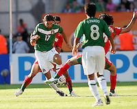 Jose Fonseca of Mexico jiggles out of danger. Mexico defeated Iran 3-1 during a World Cup Group D match at Franken-Stadion, Nuremberg, Germany on Sunday June 11, 2006.