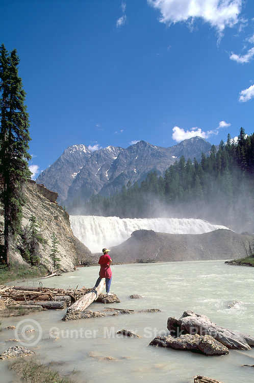 Yoho National Park, Canadian Rockies, BC, British Columbia, Canada - Hiker standing beside Wapta Falls, Kicking Horse River, Summer (Model Released)
