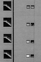 Detail image of stairs and windows in a high rice apartment building in Shinagawa, Tokyo, Japan. Tuesday March 17th 2015
