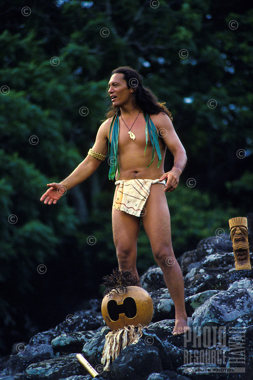 Hawaiian man chanting at a Hawaiian Heiau (temple)