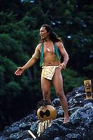Hawaiian man chanting at a Hawaiian Heiau (temple)