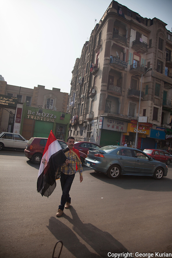 A street peddler sells flags on the streets of Cairo on Election day. Many people were seen waving Egyptian flags.
