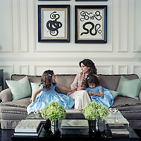 Giulia Azmoudeh with her daughers Amber and Mia on the custom-made sofa in their elegant drawing room