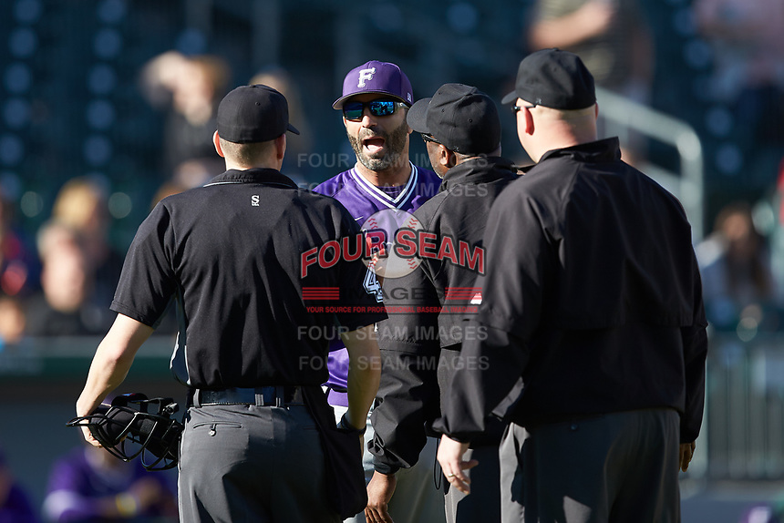 Furman Paladins head coach Brett Harker argues a call with umpires Jon Byrne (left), Limus Baker (center), and Wilson Raynor during the game against the Wake Forest Demon Deacons at BB&T BallPark on March 2, 2019 in Charlotte, North Carolina. The Demon Deacons defeated the Paladins 13-7. (Brian Westerholt/Four Seam Images)