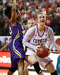 VERMILLION, SD - MARCH 24, 2016 -- Nicole Seekamp #35 of South Dakota drives past Sharnae Lamar #13 of Northern Iowa during their WNIT game Thursday evening at the Dakotadome in Vermillion, S.D.  (Photo by Dick Carlson/Inertia)