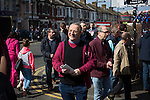 West Ham United 2 Crystal Palace 2, 02/04/2016. Boleyn Ground, Premier League. Fans making their way towards the ground on the corner of Green Street and Castle Street near the Boleyn Ground before West Ham United hosted Crystal Palace in a Barclays Premier League match. The Boleyn Ground at Upton Park was the club's home ground from 1904 until the end of the 2015-16 season when they moved into the Olympic Stadium, built for the 2012 London games, at nearby Stratford. The match ended in a 2-2 draw, watched by a near-capacity crowd of 34,857. Photo by Colin McPherson.