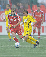 Carl Robinson (33) and Brian Carroll (16) in action at  BMO Field on Saturday September 13, 2008. .The game ended in a 1-1 draw.