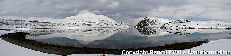 Eidvågen på Seiland en vårdag. Hønsebyfjellet til venstre for midten og Skarvfjellet til høyre. ---- Spring day on Seiland.