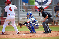 Seton Hall Pirates catcher Mike Alescio (51) and umpire Mike Savakinas await the pitch with Tony Butler (4) at bat during a game against the Indiana Hoosiers on March 5, 2016 at North Charlotte Regional Park in Port Charlotte, Florida.  Seton Hall defeated Indiana 6-4.  (Mike Janes/Four Seam Images)