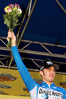 Yaroslav Popovych, of the Discovery Channel Pro Cycling Team, celebrates taking third overall in the Ford Tour de Georgia. Floyd Landis of Phonak Hearing Systems won the six-stage Tour de Georgia.<br />