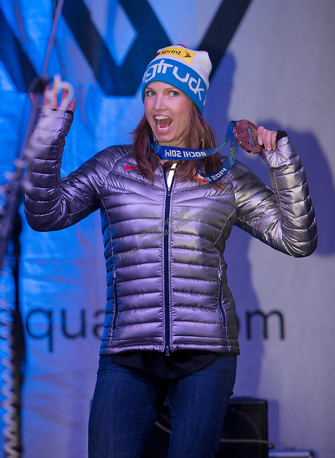Julia Mancuso shows off her gold medal during the Olympic Homecoming Celebration at Squaw Valley on Friday night, March 21, 2014.