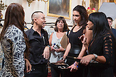 London, UK. 13 September 2014. Designer Julien Macdonal with assistants backstage. Backstage at the Julien Macdonald show at London Fashion Week SS15 at the Royal Opera House in London, England. Photo: CatwalkFashion/Alamy Live News