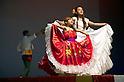 """Minamisanriku, Miyagi, Japan - Colombian girls with traditional dress dance for Japanese refugees at Sports Koryu Mura in Minamisanriku, one year after the tsunami. The Latin group of volunteers """"Todos con Japon"""" visits Miyagi area during this Golden Week."""