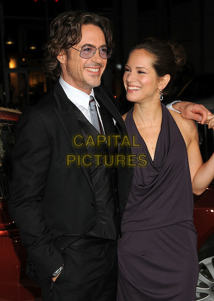 "ROBERT DOWNEY JR. & SUSAN DOWNEY .""Due Date"" Los Angeles Premiere held at Grauman's Chinese Theatre, Hollywood, California, USA,.28th October 2010..half length glasses grey gray white shirt tie red suit purple dress cowel neck  husband wife couple lack waistcoat arm around smiling .CAP/ADM/BP.©Byron Purvis/AdMedia/Capital Pictures."